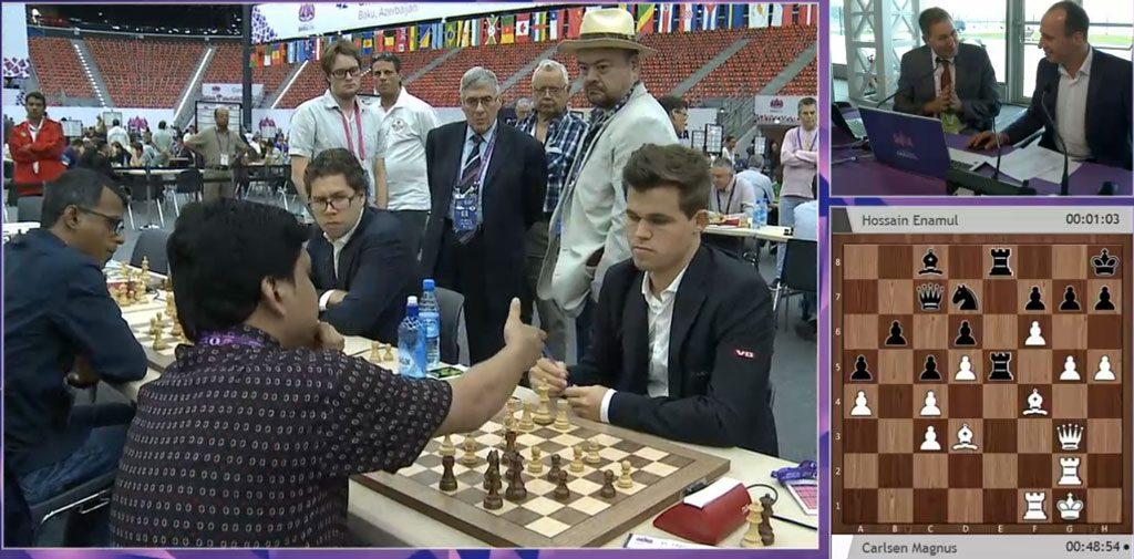Enamul Hossain gir opp mot Magnus Carlsen. Foto: ChessCast/Baku Chess Olympiad