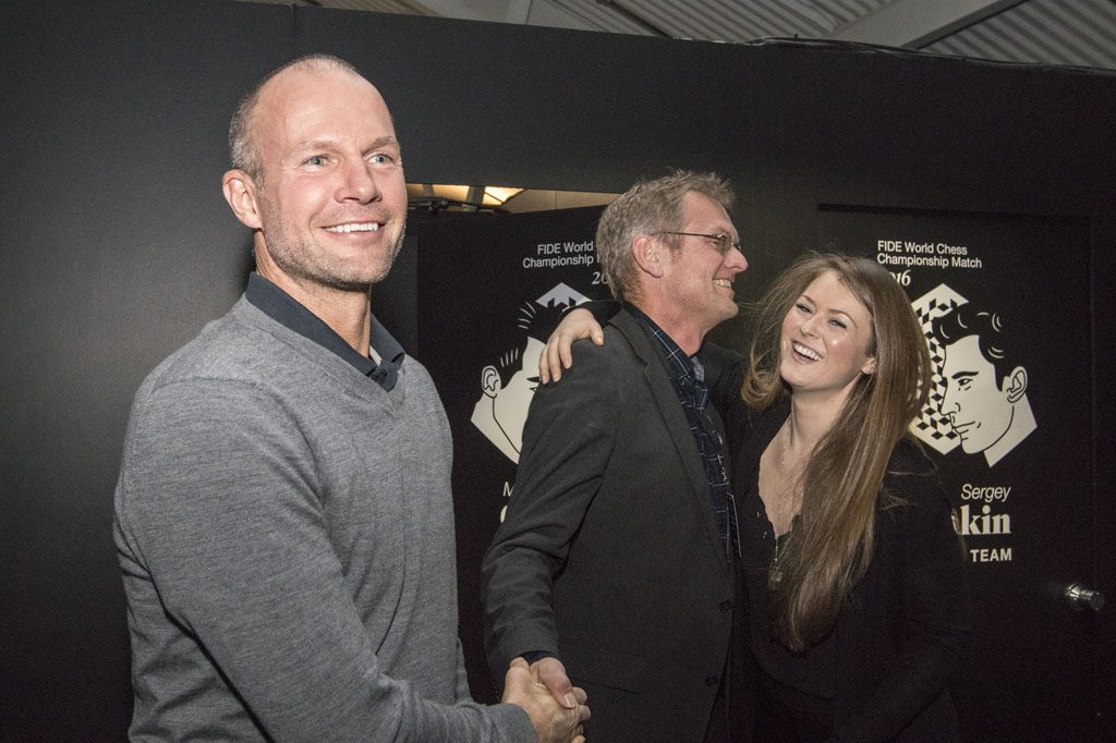"Joy in the Carlsen camp once their boss won his first game. Here with ex professional sandvolleyball player Jørre Kjemperud, ""security man"" Bjørn Gunnar Nesse, and Play Magnus CEO Kate Murphy. Photo: Maria Emelianova"