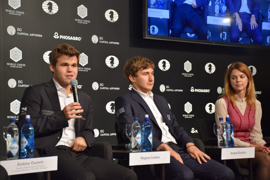 Magnus Carlsen and Sergey Karjakin at the press conference after the game, led by FIDE press officer Anastasiya Karjlovich. Photo: Yerazik Khachatourian