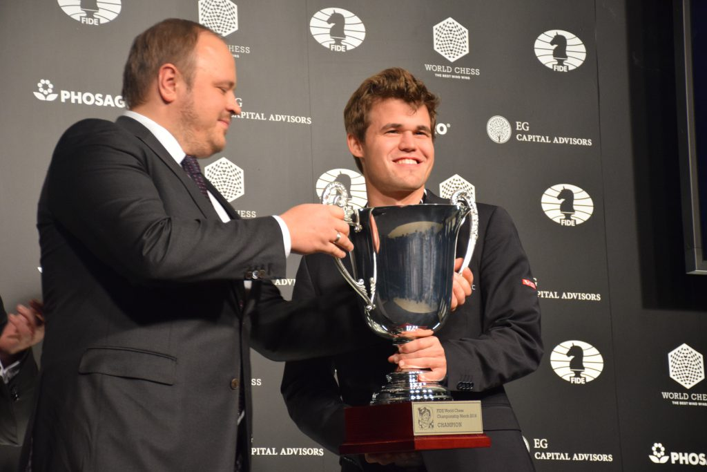 Magnus Carlsen gets the trophy he was looking for. Photo: Yerazik Khachatourian