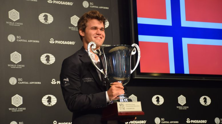 Magnus Carlsen with the World Championship trophy. Photo: Yerazik Khachatourian