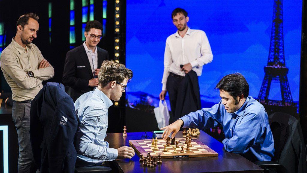 PRESTISJE: Magnus Carlsen var i trøbbel mot Hikaru Nakamura, men reddet remis etter rot av amerikaneren i sluttspillet. Foto: Lennart Ootes