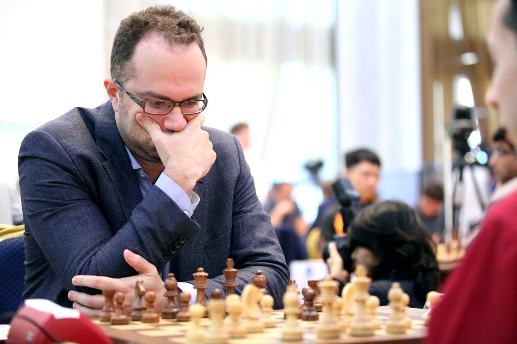 Pavel Eljanov knocked out by Alex Lenderman. Photo: Anastasiya Karlovich/FIDE