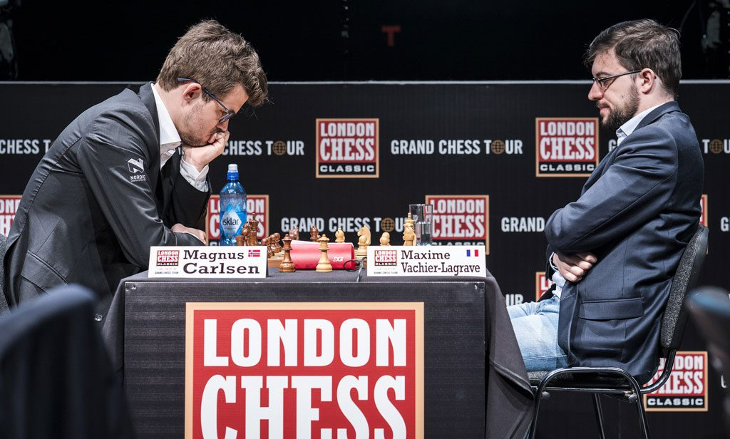 RIVALER: Maxime Vachier-Lagrave og Magnus Carlsen møttes for 17. gang i klassisk sjakk. Foto: Lennart Ootes/Grand Chess Tour