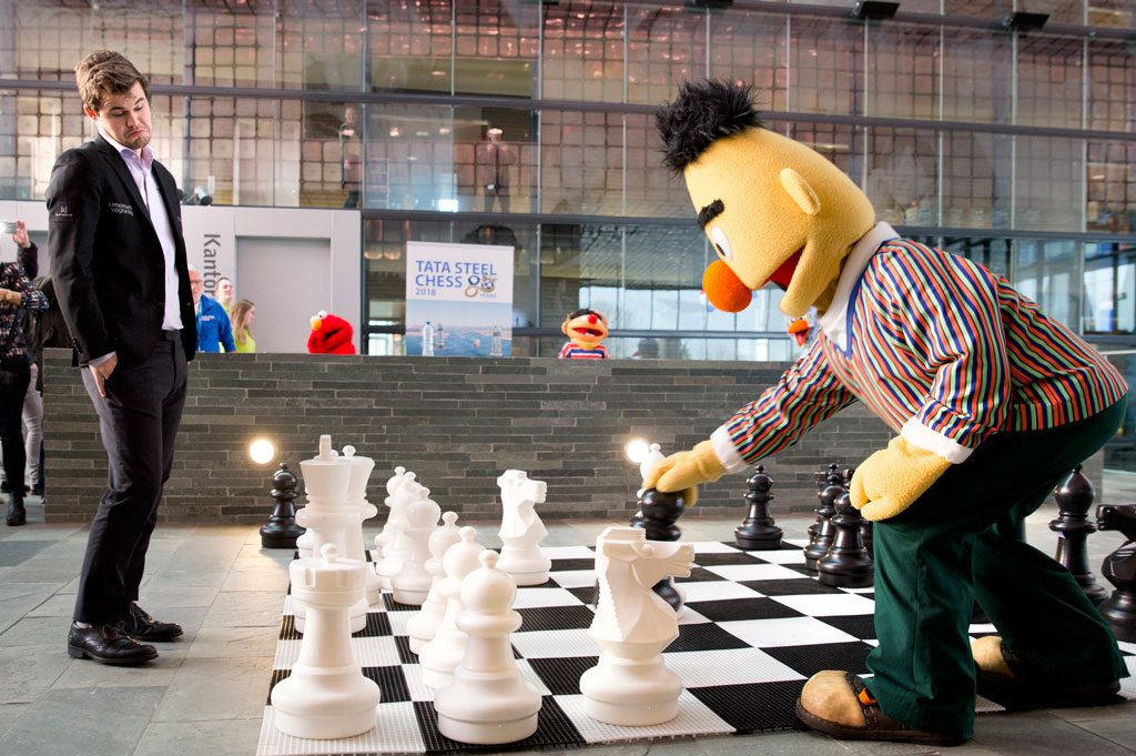 Magnus Carlsen surprised by Sesame Street Bernd's illegal move. Photo: Tata Steel Chess