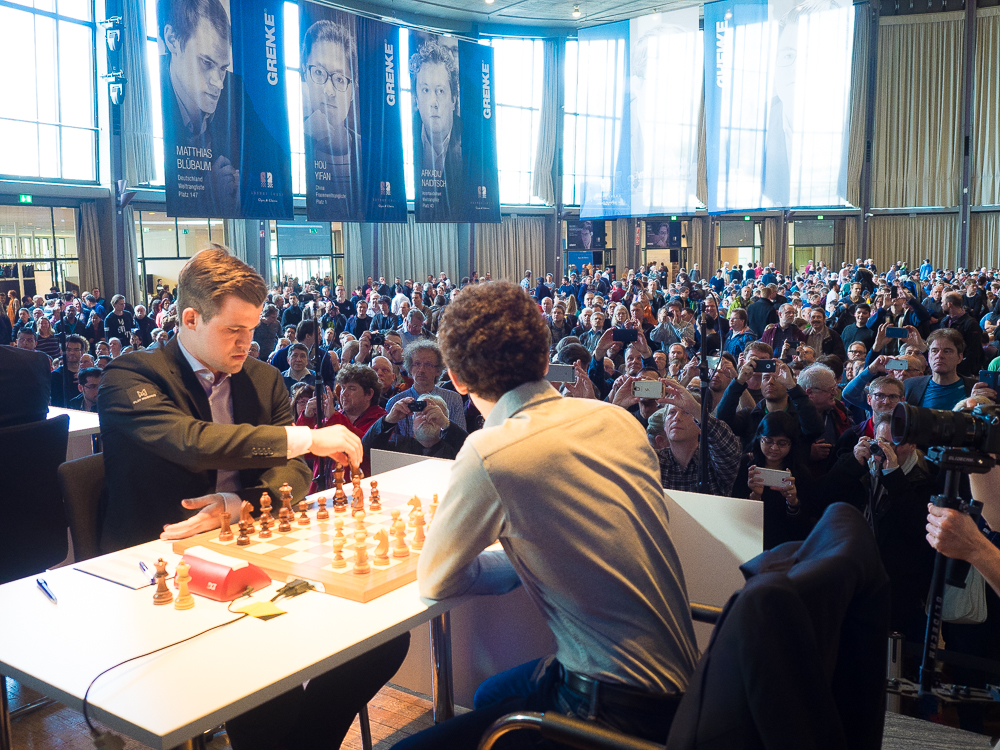 Magnus Carlsen was close to score his 10th win against his World Championship Match challenger Fabiano Caruana in the 1st round of Grenke Chess Classic. Photo: Eric van Reem