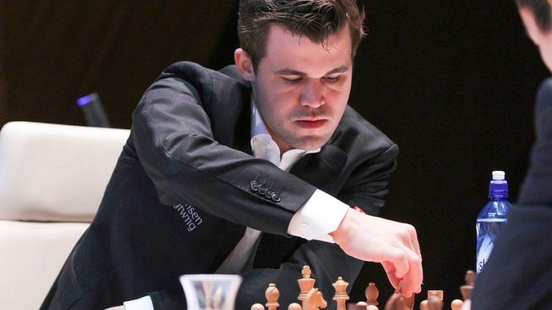 TRIUMF: Magnus Carlsen vant for tredje gang i Shamkir. Her i møtet med Ding Liren i 9. runde. Foto: shamkirchess.com