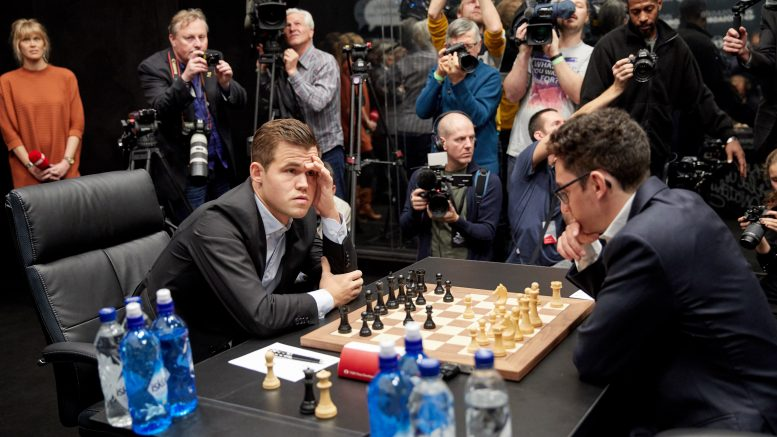 LONDON, ENGLAND - NOVEMBER 09: Magnus Carlsen, the reigning World Chess Champion (R) and Fabiano Caruana, US Challenger during the First Move Ceremony (Round 1) of the FIDE World Chess Championship Match 2018 on November 9, 2018 in London, England. (Photo by Tristan Fewings/Getty Images for World Chess ) *** Local Caption *** Magnus Carlsen; Fabiano Caruana