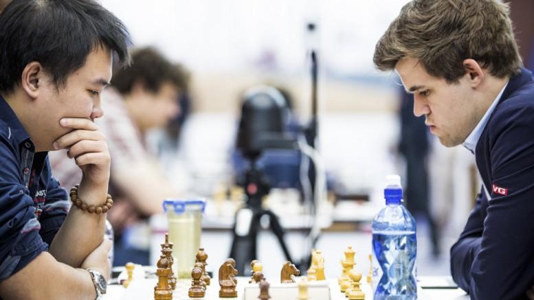 Chao Li i partiet mot Magnus Carlsen. Foto: Kateryna Savina
