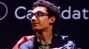 CHALLENGER: Fabiano Caruana with the American flag after being crowned as the Challenger to Magnus Carlsen in 2018. Photo: World Chess